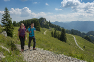 Germany, Bavaria, Brauneck near Lenggries, young couple hiking in alpine landscape - LBF02088