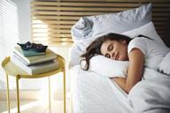 Portrait of woman sleeping in bed by daylight - ABIF01005