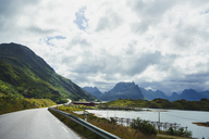 Norway, Lofoten, rural landscape with road, mountains and waters - KKAF01858