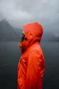 Norway, Lofoten, profile view of man with full beard at the coast - KKAF01873