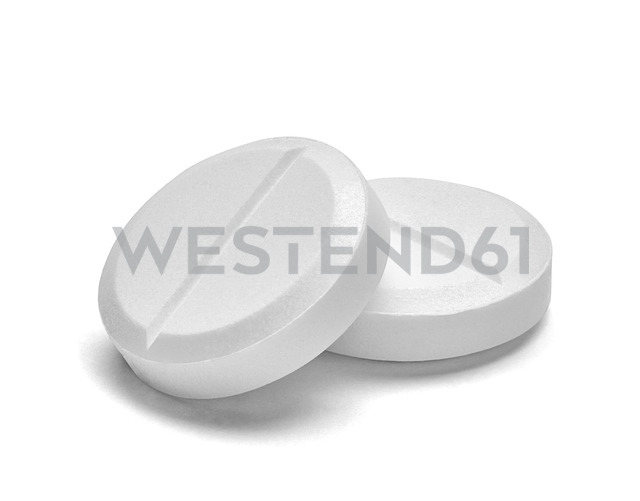 Two white pills on white background, close-up - RAMF00069