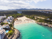 Spain, Mallorca, Portocolom, Aerial view of Punta des Jonc, Bay of Cala Marcal, beach with tourists - AMF05914