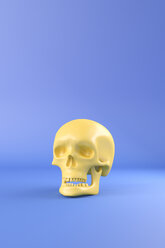 3D Rendering, Yellow skull against blue background - AHUF00543