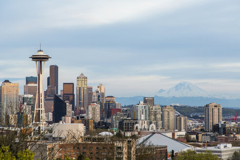 Downtown Seattle at dusk with views of the Space Needle and Mount Rainier. - AURF05067