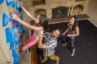 High Angle View Of Family Playing On A Climbing Wall In House - AURF05169