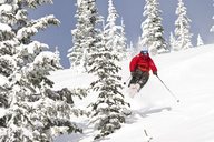 Male Skier Jumping On Snowy Landscape At Whitefish Mountain Resort In Whitefish, Montana - AURF05289