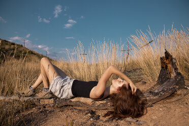 Young woman lying the rural landscape - AFVF01565