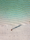 Indonesia, Bali, Melasti, Aerial view of Karma Kandara beach, woman standing on the beach - KNTF01644