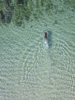Indonesia, Bali, Aerial view of snorkeler - KNTF01653