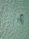 Indonesia, Bali, Melasti, Aerial view of Karma Kandara beach, one woman in water - KNTF01662
