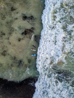 Indonesia, Bali, Aerial view of Dreamland beach, three surfers from above - KNTF01738