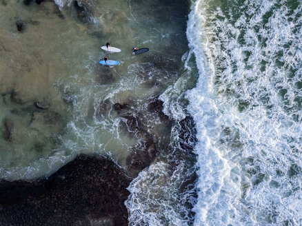 Indonesia, Bali, Aerial view of Dreamland beach, three surfers from above - KNTF01741