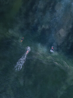 Indonesia, Bali, Aerial view of Dreamland beach, three surfers from above - KNTF01753