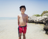 Portrait of a boy standing on the beach - AZOF00044