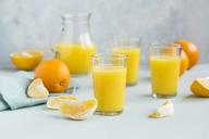 Glasses of freshly squeezed orange juice and orange slices - JUNF01262