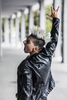 Rear view of screaming punk woman at an arcade - GIOF04414