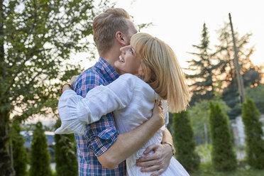 Happy couple hugging outdoors - ZEDF01560