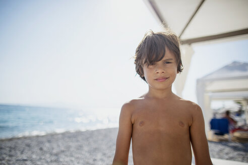 Portrait of tanned boy on the beach - AZOF00057