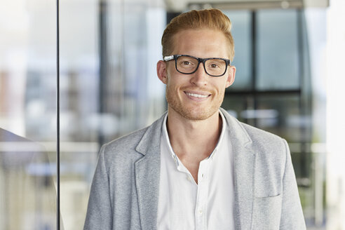 Portrait of smiling redheaded businessman wearing glasses - RBF06724