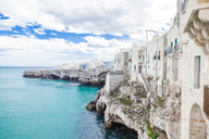 Italy, Puglia, Polognano a Mare, view of historic old town at seaside - FLMF00044