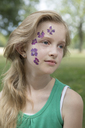 Portrait of blond girl with tattoo of pressed flowers on her face - PSTF00257