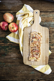 Home-baked Apple Pie on wooden board - GIOF04490