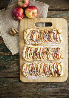Home-baked Apple Pie on wooden board - GIOF04493