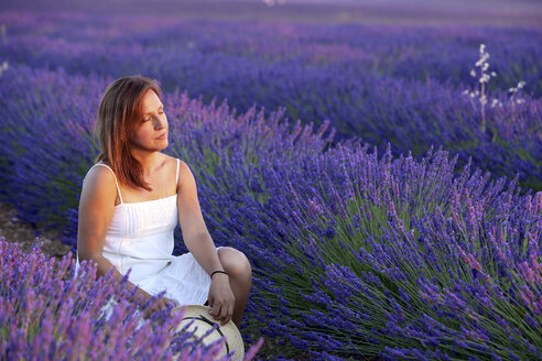Woman Relaxing In The Field Of Lavender - AURF05764