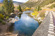 A Fly Fisherman On The Eagle River Surrounded By Fall Colors In Breckenridge, Colorado - AURF05887