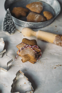 Stack of star-shaped Christmas Cookies and cookie cutters - MOMF00496