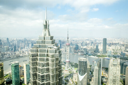 High angle view of cityscape against cloudy sky - CAVF48788