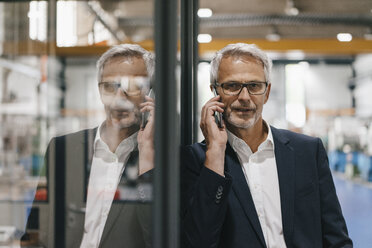 Manager talking on the phone in high tech company - KNSF04822