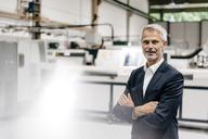 Portrait of a successful entrepreneur in his company - KNSF04861
