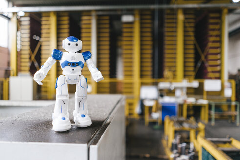 Toy robot standing on shelf in logistics center - KNSF04918