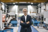 Portrait of a successful entrepreneur in his company - KNSF04948