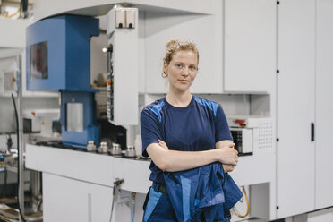 Young woman working as a skilled worker in a high tech company, portrait - KNSF04951