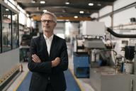 Portrait of a successful entrepreneur in his company - KNSF04969