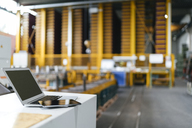 Laptop and digital tablet in logistics center - KNSF04978