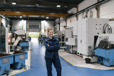 Young woman working as a skilled worker in a high tech company, portrait - KNSF04987