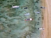 Indonesia, Bali, Aerial view of Padangbai, bay, beach, banca boats - KNTF01856