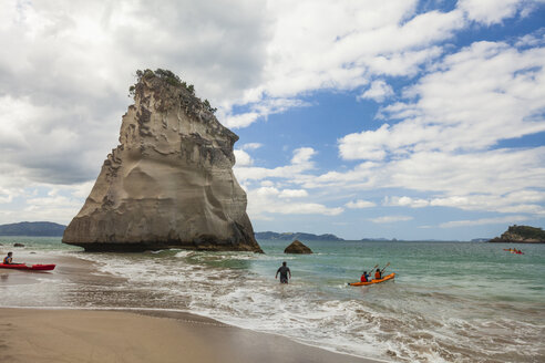 Clouds over people kayaking beside Te Hoho Rock during sunny weather, New Zealand - AURF06753