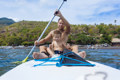 Father and son on sup surfboard,Bali,Indonesia. - AURF06891