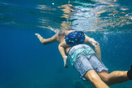 Father and son diving under water,Bali,Indonesia - AURF06894