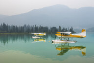 Float planes moored on Green Lake, Whistler, British Columbia, Canada - AURF06999
