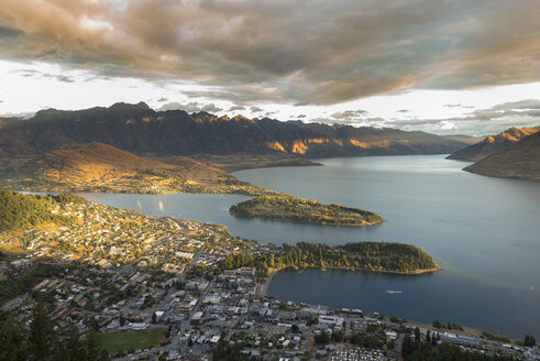 New Zealand, South Island, Queenstown and Lake Wakatipu at sunset - MKFF00407