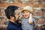 Portrait of happy toddler on his father's arms - HAPF02721