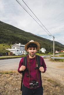 Young man traveling through Norwegian Lapland - KKAF02041