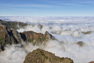 Madeira, Pico Ruivo, Sea of clouds below mountain peaks seen from Pico do Areeiro - RUEF02012
