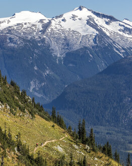 Snowcapped mountain peak and forested valley, Whistler, British Columbia, Canada - AURF07448