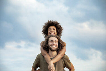 Portrait of happy carefree couple outdoors - FMKF05268